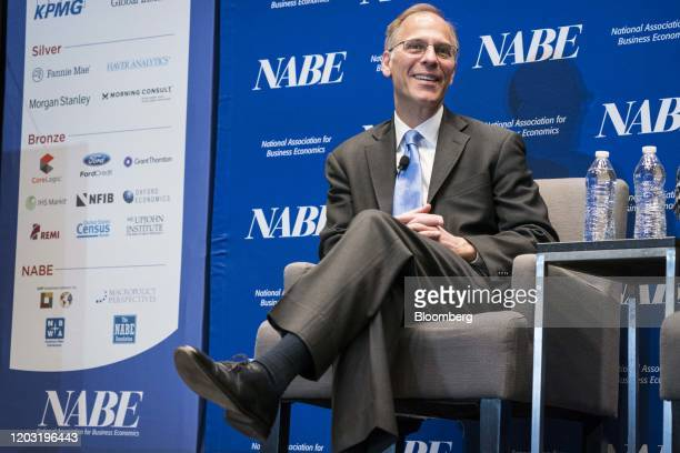 Mark Zandi chief economist at Moody's Analytics Inc smiles during the National Association of Business Economics economic policy conference in...
