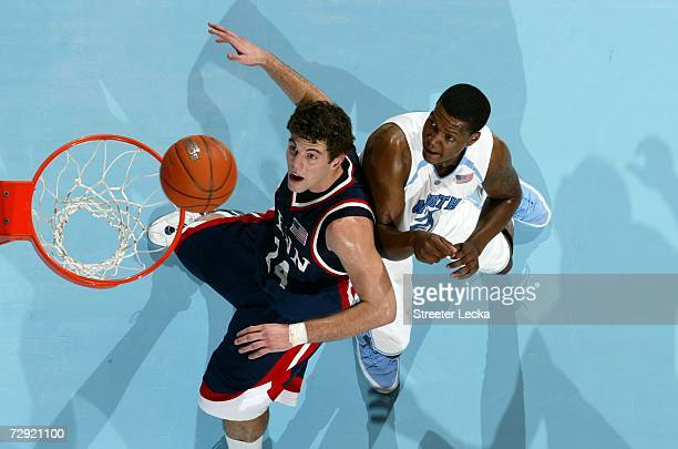 Mark Zoller of the Pennsylvania Quakers waits for a rebound with Deon Thompson of the University of North Carolina Tar Heels on January 3 2007 at the...
