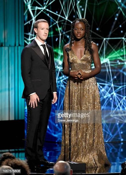 Mark Zuckerberg and Lupita Nyong'o speak onstage at the 2019 Breakthrough Prize at NASA Ames Research Center on November 4 2018 in Mountain View...