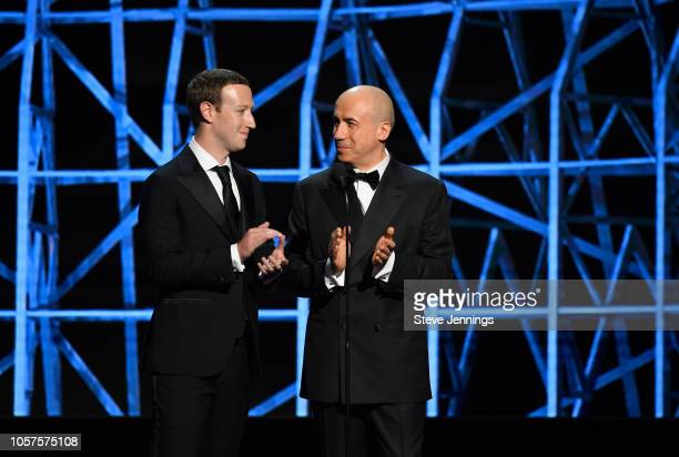 Mark Zuckerberg and Yuri Milner onstage at the 2019 Breakthrough Prize at NASA Ames Research Center on November 4 2018 in Mountain View California