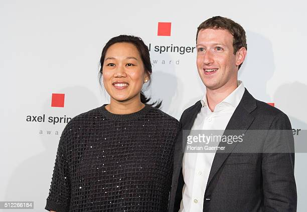 Mark Zuckerberg CEO and founder of the social media platform Facebook and his wife Pricilla Chan pose for a photo before the AxelSpringerAward on...
