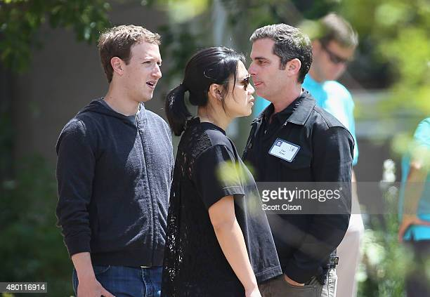 Mark Zuckerberg chief executive officer and founder of Facebook Incand his wife Priscilla Chan chat with Dan Rose VP of Business Development and...