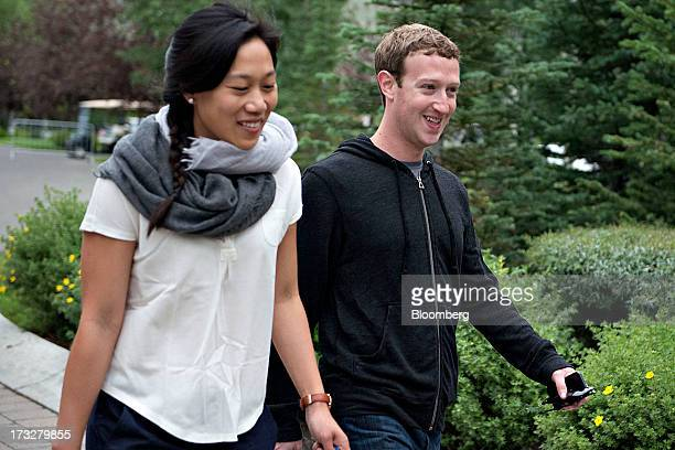 Mark Zuckerberg chief executive officer and founder of Facebook Inc walks with his wife Priscilla Chan while arriving for a morning session during...