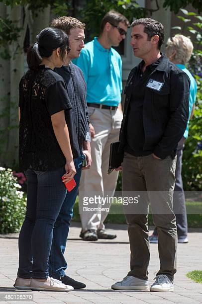 Mark Zuckerberg chief executive officer and founder of Facebook Inc second left his wife Priscilla Chan left and Dan Rose vice president of...