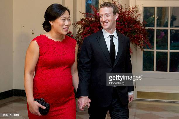 Mark Zuckerberg chief executive officer and founder of Facebook Inc right and his wife Priscilla Chan arrive at a state dinner in honor of Chinese...