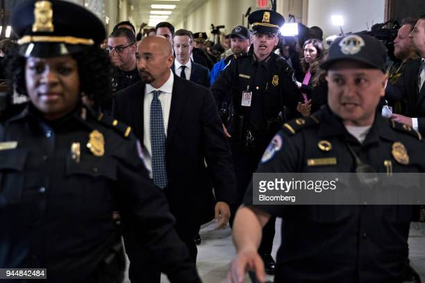 Mark Zuckerberg chief executive officer and founder of Facebook Inc center walks through the Rayburn House Office building after a House Energy and...