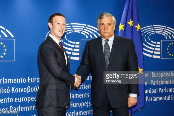 Mark Zuckerberg chief executive officer and founder of Facebook Inc left shakes hands with Antonio Tajani president of the European Parliament as he...