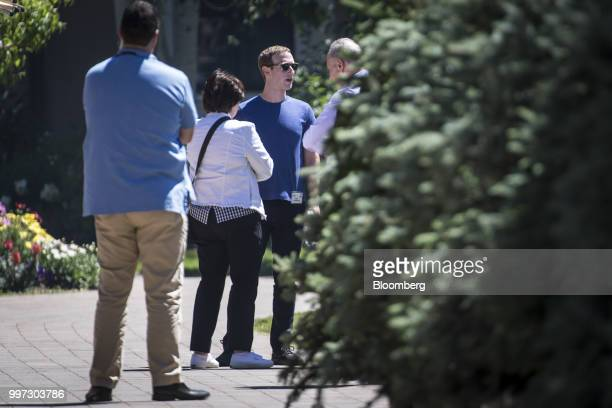 Mark Zuckerberg chief executive officer and founder of Facebook Inc second from right speaks with Senate Minority Leader Chuck Schumer a Democrat...