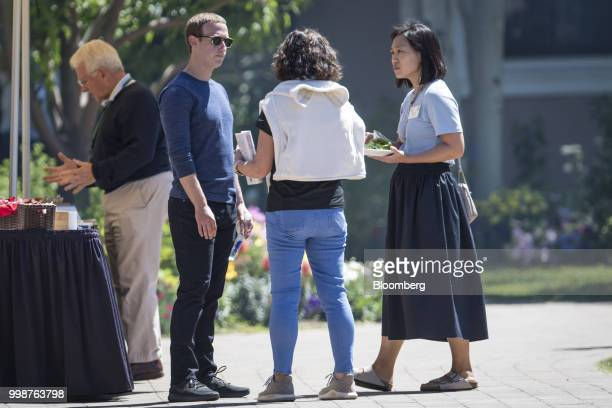 Mark Zuckerberg chief executive officer and founder of Facebook Inc left speaks with an attendee as Priscilla Chan cofounder of the Chan Zuckerberg...