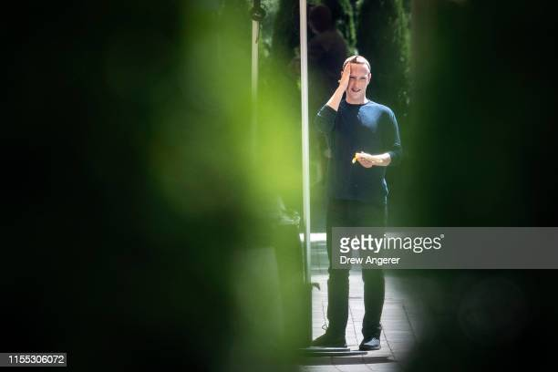 Mark Zuckerberg, chief executive officer of Facebook, applies sunscreen at the annual Allen & Company Sun Valley Conference, July 12, 2019 in Sun...