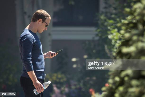 Mark Zuckerberg, chief executive officer of Facebook, checks his phone during the annual Allen & Company Sun Valley Conference, July 13, 2018 in Sun...