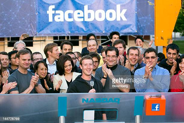 Mark Zuckerberg chief executive officer of Facebook Inc center speaks during the remote opening bell ringing cerermony for the opening of trading at...