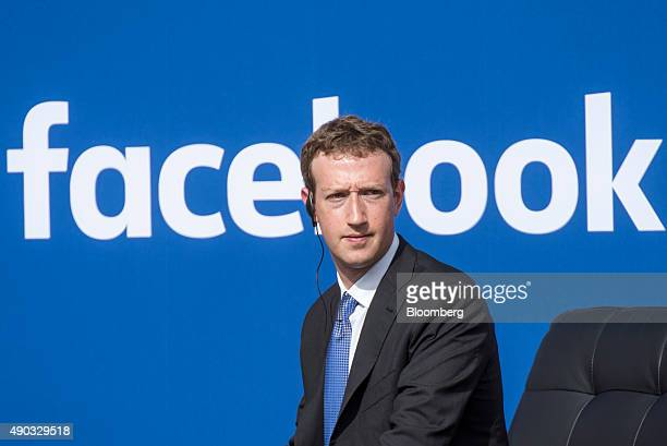 Mark Zuckerberg, chief executive officer of Facebook Inc., listens as Narendra Modi, India's prime minister, not pictured, speaks during a town hall...
