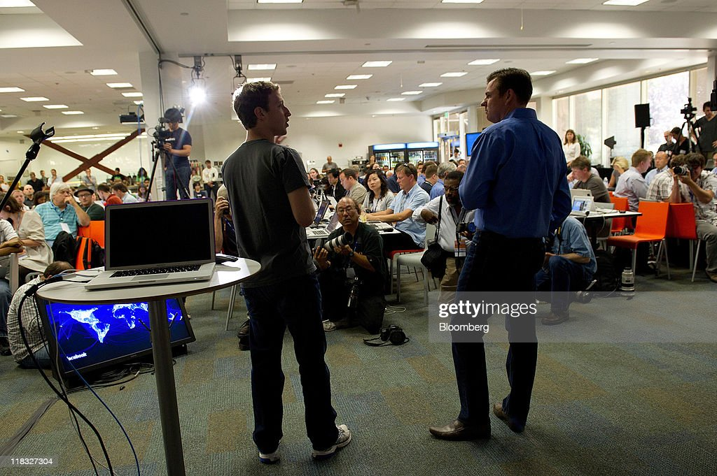 Mark Zuckerberg, co-founder and chief executive officer of Facebook Inc., left, and Tony Bates, chief executive officer of Skype Technologies SA, answer question during a press event at Facebook headquarters in Palo Alto, California, U.S., on Wednesday, July 6, 2011. Facebook Inc., the world's largest social-networking service, is offering free video calls over its site through a partnership with Skype Technologies SA. Photographer: David Paul Morris/Bloomberg via Getty Images