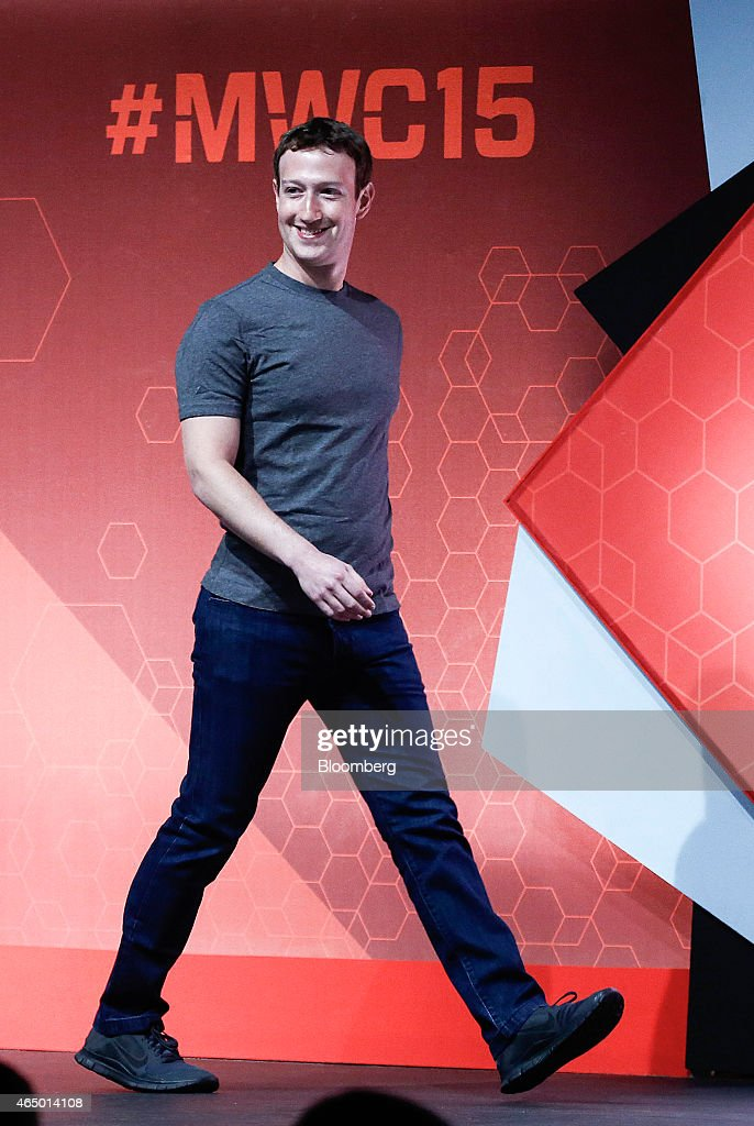 Mark Zuckerberg, co-founder and chief executive officer of Facebook Inc., arrives on stage for a keynote session at the Mobile World Congress in Barcelona, Spain, on Monday, March 2, 2015. The event, which generates several hundred million euros in revenue for the city of Barcelona each year, also means the world for a week turns its attention back to Europe for the latest in technology, despite a lagging ecosystem. Photographer: Simon Dawson/Bloomberg via Getty Images