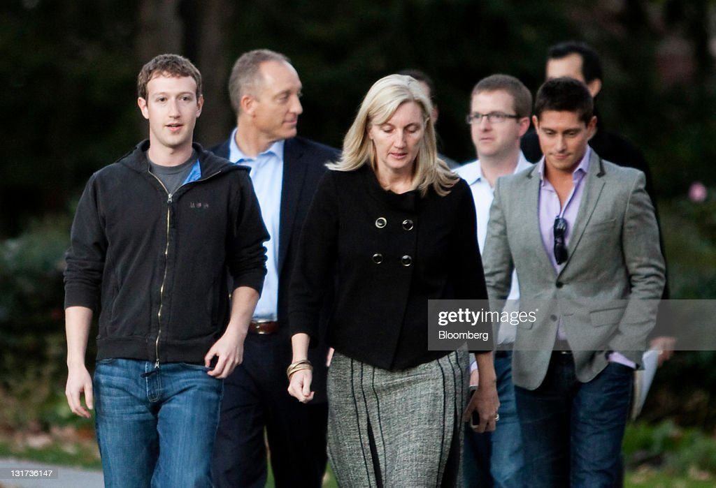 Mark Zuckerberg, founder and chief executive officer of Facebook Inc., left, arrives to speak during a news conference at Harvard University in Cambridge, Massachusetts, U.S., on Monday, Nov. 7, 2011. Zuckerberg said Apple Inc. co-founder Steve Jobs advised him on how to sharpen his company's focus and build the right management team for the world's largest social network. Photographer: Kelvin Ma/Bloomberg via Getty Images
