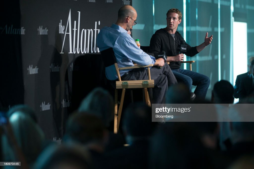 Mark Zuckerberg, founder and chief executive officer of Facebook Inc., right, speaks to James Bennet, editor-in-chief of the Atlantic, during an interview at the Newseum in Washington, D.C., U.S., on Wednesday, Sept. 18, 2013. Zuckerberg said helping 11 million undocumented U.S. residents is the most important aspect of immigration issues he's exploring with congressional leaders during a Washington visit. Photographer: Andrew Harrer/Bloomberg via Getty Images