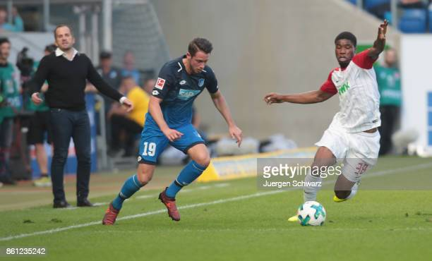 MarkAlexander Uth of Hoffenheim and Kevin Danso of Augsburg fight for the ball during the Bundesliga match between TSG 1899 Hoffenheim and FC...