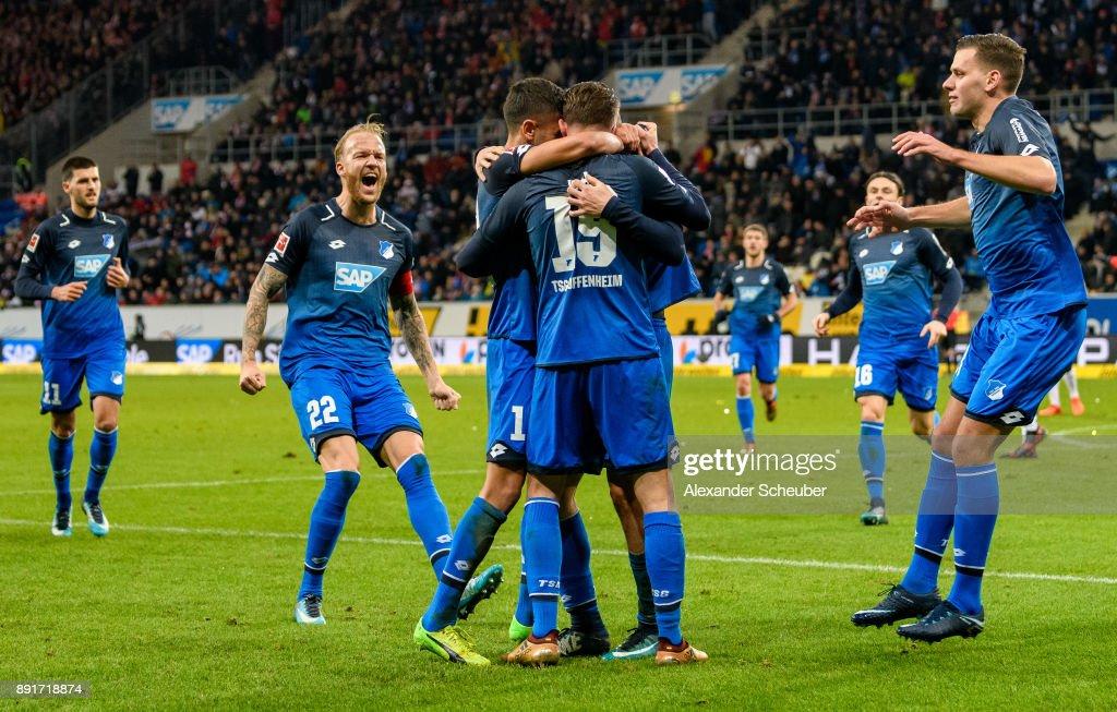 Mark-Alexander Uth of Hoffenheim celebrates the first goal for his team with his teammates during the Bundesliga match between TSG 1899 Hoffenheim and VfB Stuttgart at Wirsol Rhein-Neckar-Arena on December 13, 2017 in Sinsheim, Germany.