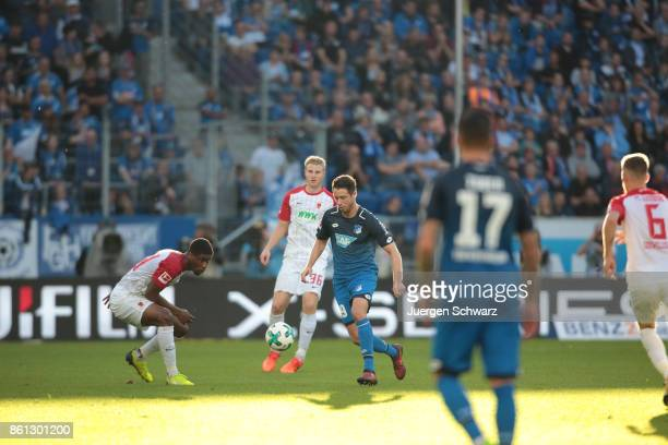 MarkAlexander Uth of Hoffenheim tackles Kevin Danso of Augsburg during the Bundesliga match between TSG 1899 Hoffenheim and FC Augsburg at Wirsol...