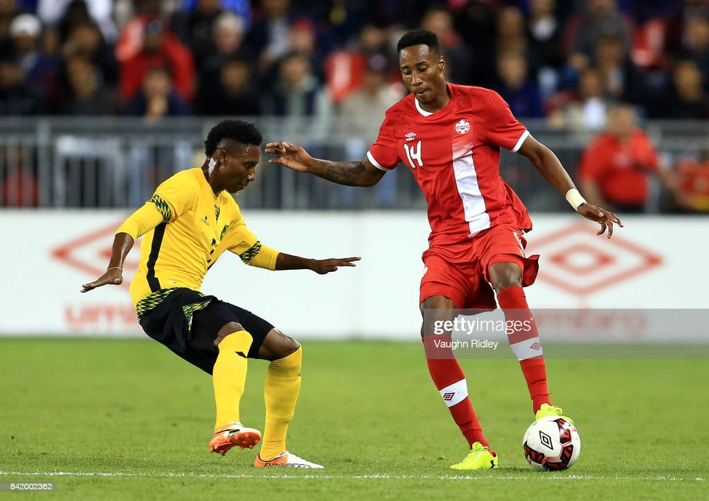 Mark-Anthony Kaye #14 of Canada battles for the ball with Devon Williams #7 of Jamaica during the second half of an International Friendly match at BMO Field on September 2, 2017 in Toronto, Canada.