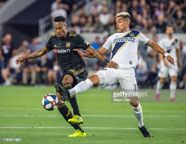 MarkAnthony Kaye of Los Angeles FC battles Favio Alvarez of Los Angeles Galaxy during Los Angeles FC's MLS match against Los Angeles Galaxy at the...