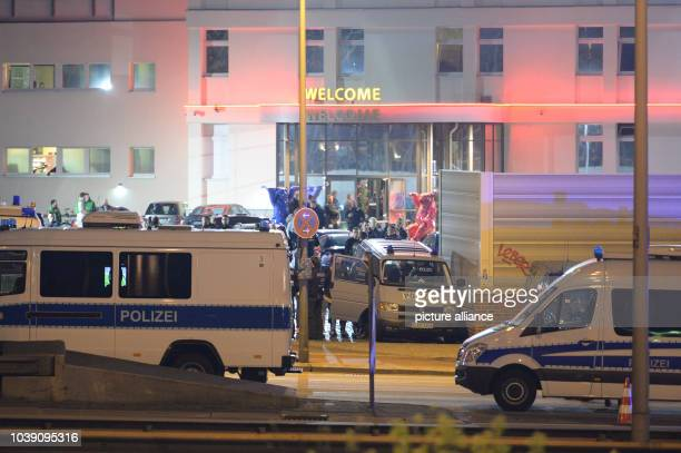Marked police vehicles stand in front of the Artemis brothel as police officers tax fraud investigators and customes officers search the premises of...