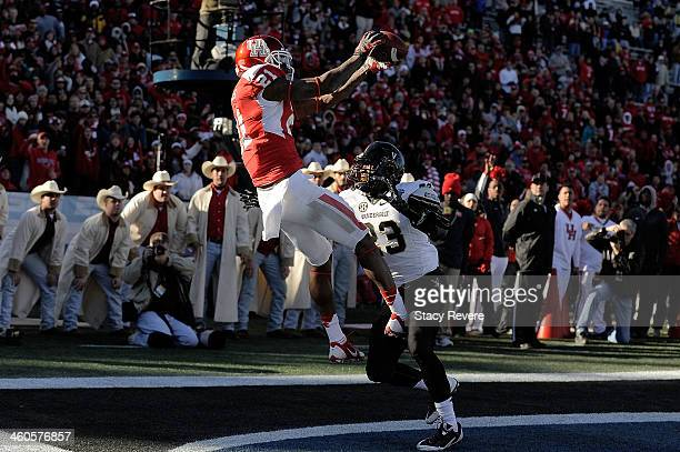 Markeith Ambles of the Houston Cougars catches a pass for a touchdown in front of Andre Hal of the Vanderbilt Commodores during the BBVA Compass Bowl...