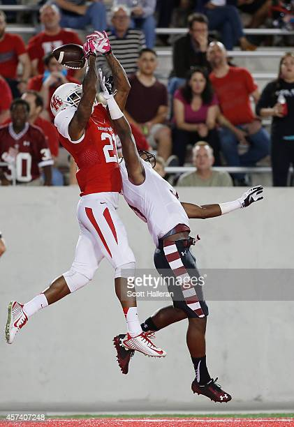 Markeith Ambles of the Houston Cougars leaps for the football against Sean Chandler of the Temple Owls in the second half of their game at TDECU...