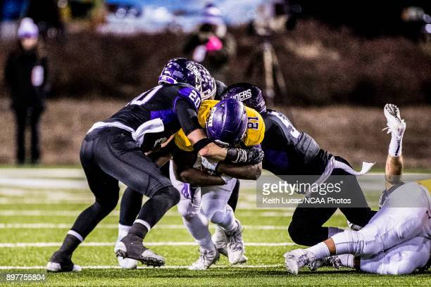 Markeith Miller of the University of Mary HardinBaylor is tackled by Austin White and Robert Powell of the University of Mount Union during the...