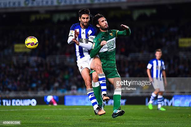 Markel Bergara Larranaga of Real Sociedad competes for the ball with Domingo Cisma of Elche FC during the La Liga match between Real Socided and...