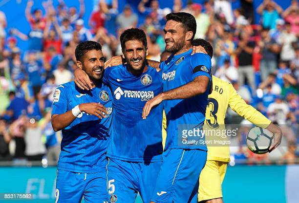 Markel Bergara of Getafe celebrates scoring his team's third goal with his teammates Angel Luis Rodriguez and Jorge Molina during the La Liga match...