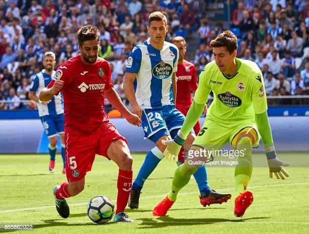 Markel Bergara of Getafe CF is challenged by Costel Pantilimon of Deportivo de La Coruna during the La Liga match between Deportivo La Coruna and...