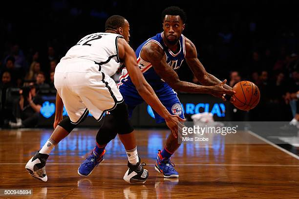 Markel Brown of the Brooklyn Nets defends against Tony Wroten of the Philadelphia 76ers at Barclays Center on December 10 2015 in Brooklyn borough of...