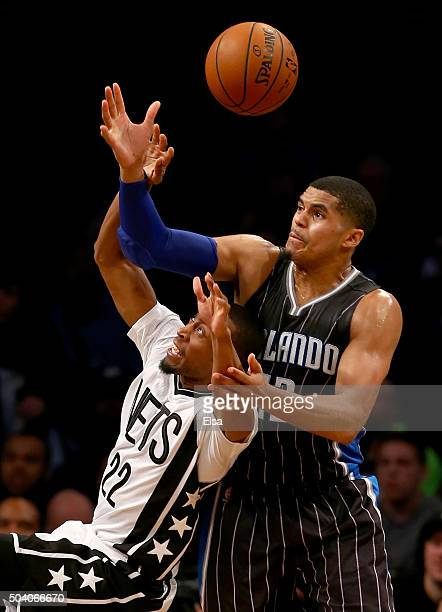 Markel Brown of the Brooklyn Nets loses control of the ball as Tobias Harris of the Orlando Magic defends on January 8,2016 at the Barclays Center in...