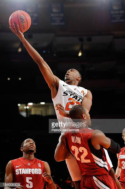 Markel Brown of the Oklahoma State Cowboys drives the ball to the basket against Jarrett Mann of the Stanford Cardinal during the 2011 Dick's...