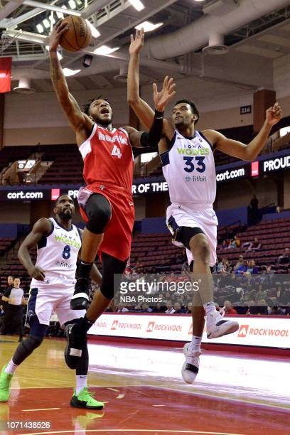 Markel Crawford of the Memphis Hustle shoots against Keita BatesDiop of the Iowa Wolves at Landers Center in an NBA GLeague game on December 7 2018...