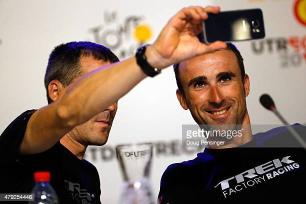 Markel Irizar of Spain takes a selfie with teammate Haimar Zubeldia of Spain riding for Trek Factory Racing during a press conference ahead of the...