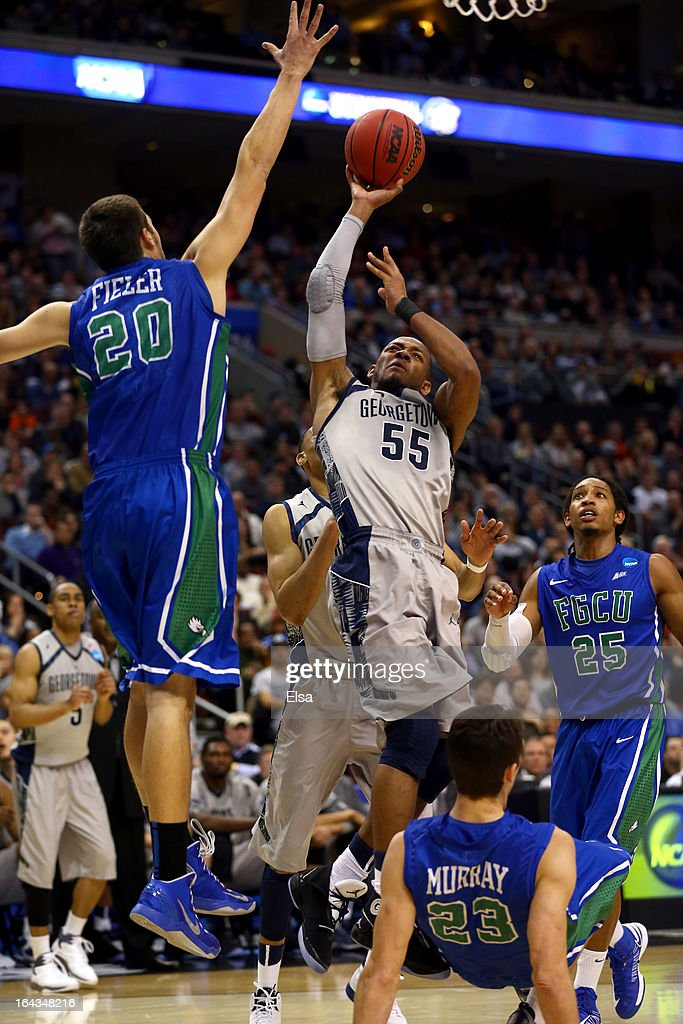 Markel Starks #5 of the Georgetown Hoyas attempts a shot in the second half against Chase Fieler #20 of the Florida Gulf Coast Eagles during the second round of the 2013 NCAA Men's Basketball Tournament at Wells Fargo Center on March 22, 2013 in Philadelphia, Pennsylvania.