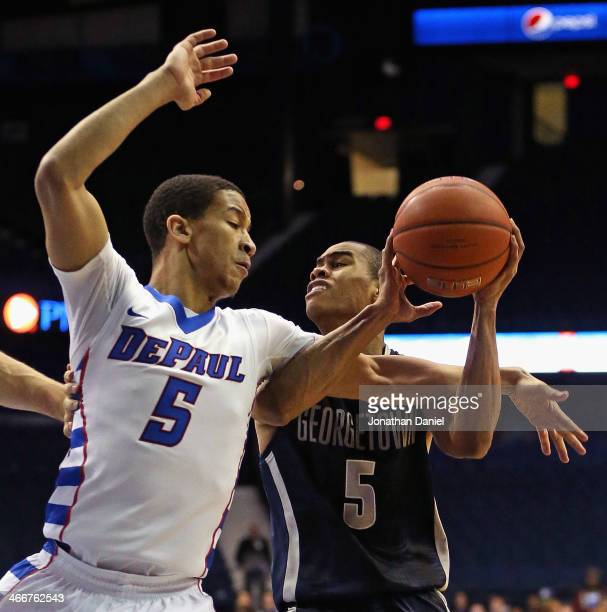 Markel Starks of the Georgetown Hoyas is fouled by Billy Garrett Jr #5 of the DePaul Blue Demons at the Allstate Arena on February 3 2014 in Rosemont...
