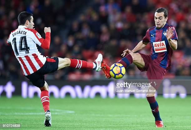 Markel Susaeta of Athletic Club competes for the ball with Gonzalo Escalante of SD Eibar during the La Liga match between Athletic Club and Eibar at...