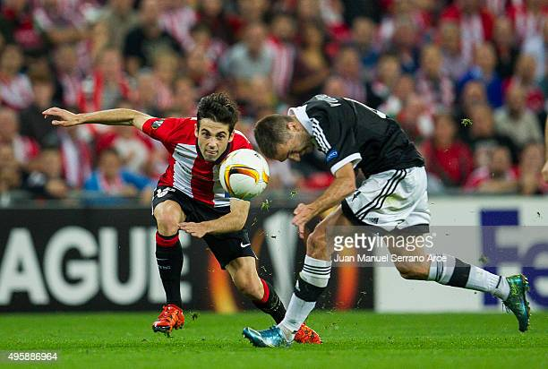 Markel Susaeta of Athletic Club duels for the ball with Miroslav Vulicevic of FK Partizan during the UEFA Europa League match between Athletic Club...