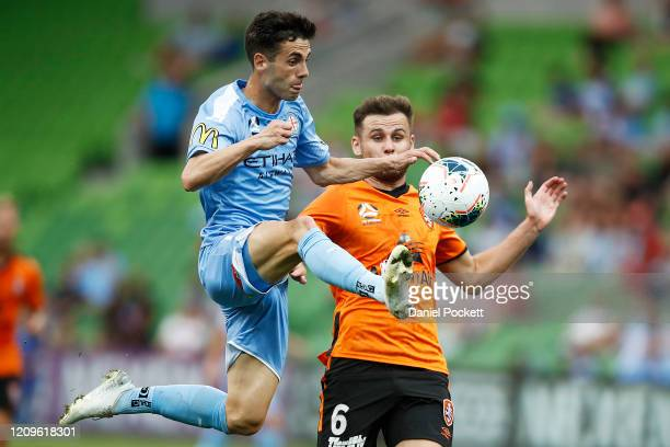 Markel Susaeta of Melbourne City and Macaulay Gillesphey of Brisbane Roar contest the ball during the round 21 ALeague match between Melbourne City...