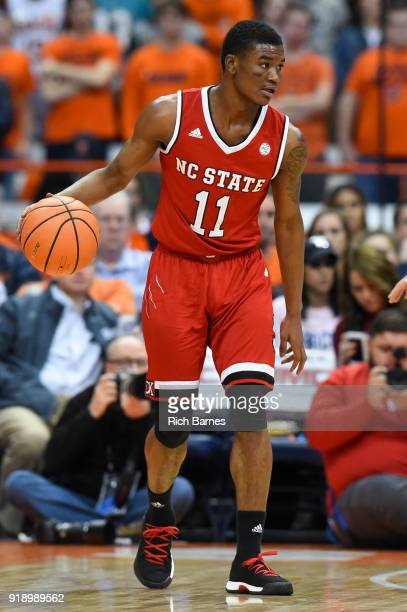 Markell Johnson of the North Carolina State Wolfpack controls the ball against the Syracuse Orange during the first half at the Carrier Dome on...