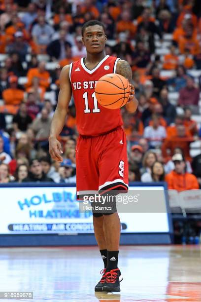 Markell Johnson of the North Carolina State Wolfpack controls the ball against the Syracuse Orange during the second half at the Carrier Dome on...