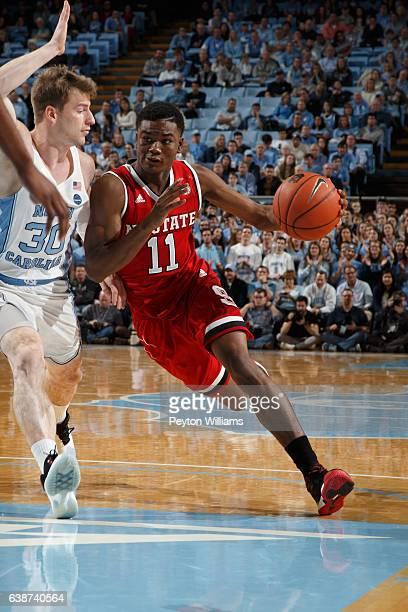 Markell Johnson of the North Carolina State Wolfpack dribbles the ball around Stilman White of the North Carolina Tar Heels on January 08 2017 at the...