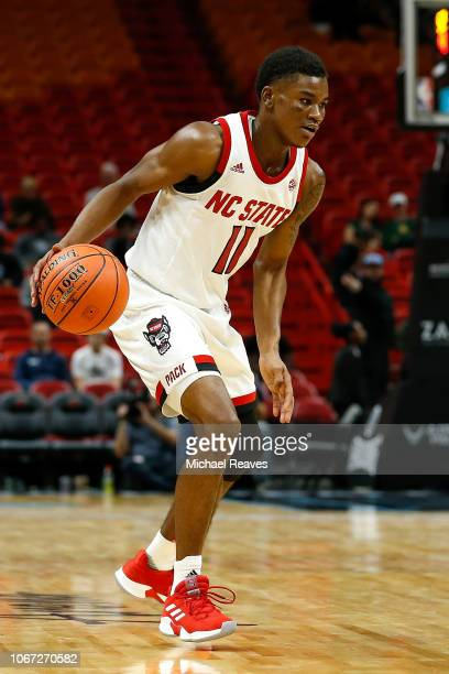 Markell Johnson of the North Carolina State Wolfpack dribbles with the ball against the Vanderbilt Commodores during the HoopHall Miami Invitational...