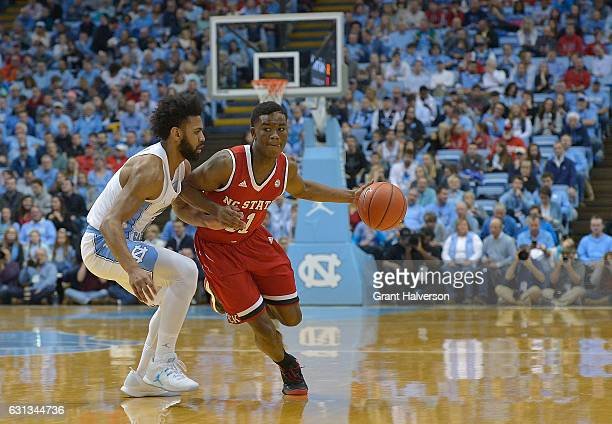 Markell Johnson of the North Carolina State Wolfpack drives against the North Carolina Tar Heels during the game at the Dean Smith Center on January...