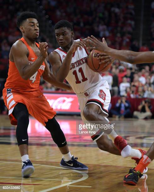 Markell Johnson of the North Carolina State Wolfpack drives against John Gillon of the Syracuse Orange at PNC Arena on February 1 2017 in Raleigh...