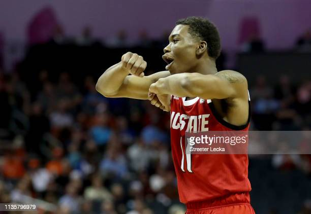 Markell Johnson of the North Carolina State Wolfpack looks for a travelling call against the Virginia Cavaliers during their game in the quarterfinal...